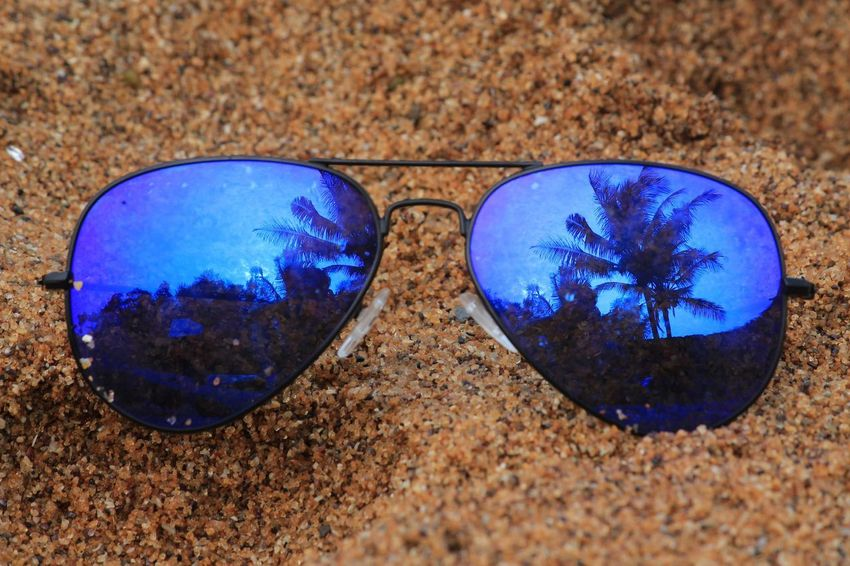no caption needed, choose yourself Tree Cocunut Trees Blue Sunglasses Outdoor Photography Beach Sand UnderSea Blue Sand Close-up Pair Things That Go Together Personal Accessory Pebble Beach Shore