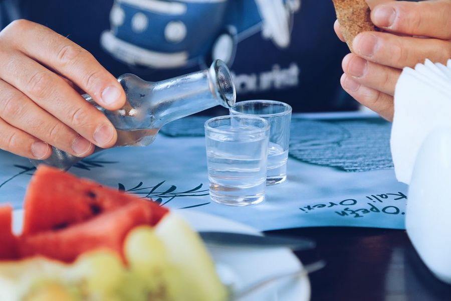 Raki drink Drinking Glass Vacation Time Pouring Drinks Pouring Greek Drink Greek Food Greece Traditional RAKI Eating Out Drink Green Grapes Watermelon Fresh Fruits Full Frame Human Hand Hand Household Equipment Human Body Part Drinking Glass Glass Food And Drink One Person Drink Holding Freshness Table Refreshment Finger Adult
