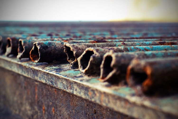 Close-up of rusty retaining wall against sea
