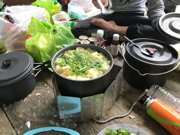 Low section of man preparing food at campsite