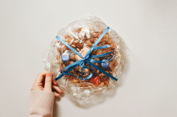 one of the Christmas sweets in Italy Traditional Food Traditional White Nuts Sweets Sweet Food Sweet Chocolate Christmas Italy Homemade Italian Italian Food Homemade Food Light Shine Ribbon Blue Ribbon Lightblue EyeEm Selects Human Body Part Human Hand Indoors  One Person People Close-up Adult One Woman Only Day