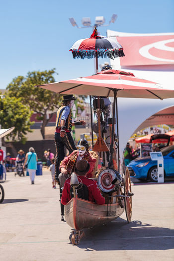 Costa Mesa, CA, USA - July 16, 2016: Dragon Knights steampunk stilt walkers perform at the Orange County Fair in Costa Mesa, CA on July 16, 2016. Editorial use only. Dance Entertainer OC Fair Orange County Fair Perform Performance Performance Art Performer  Sing Stilts Stiltwalker