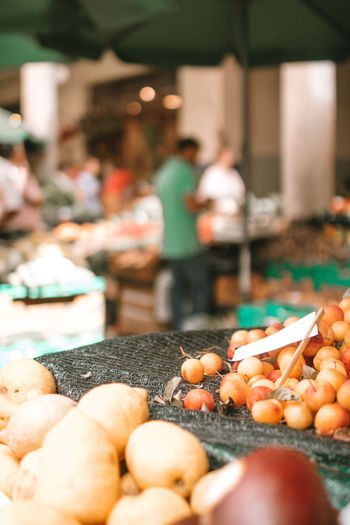 Day Focus On Foreground Food Food And Drink For Sale Freshness Healthy Eating Incidental People Large Group Of Objects Lifestyles Market Market Stall Men People Real People Retail  Selective Focus Vegetable Wellbeing