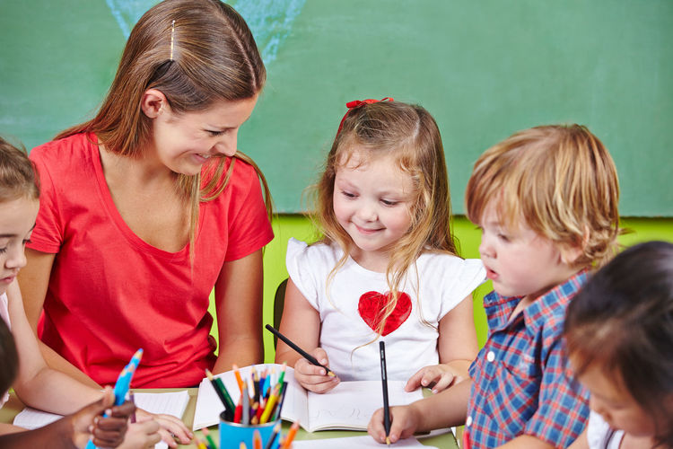 Teacher and kids in classroom
