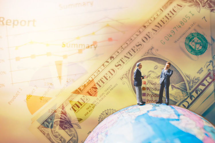 Background Business Businessman Closeup Communication Concept Figure Figurine  Global Human Investment Journey Little Macro Male Man Mini Miniature People person Professional Sign Small Success Suit World Graph Chart Money Economy Dollar Trade Deal