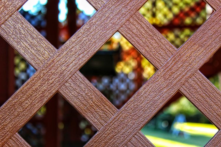 Fence pattern Pattern Brown Outside Fence Blurred Background Close-up Architecture Geometric Shape Cross Shape Textured  Architectural Detail