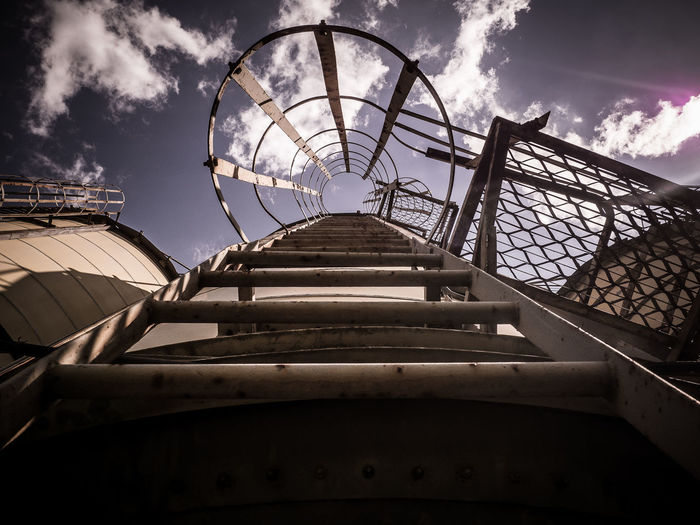 Low angle view of metallic ladder on silo