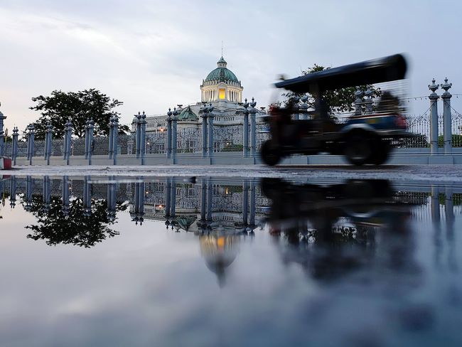 reflection of movement TukTuk 3-wheeled Taxi Reflections In The Water Huawei P20 Pro Thronehall Tuk Tuk In Bangkok After The Rain Puddle Reflections Moving Parliament Cityscape City Water Reflection Dome Politics And Government Sky Architecture Cloud - Sky Puddle Rainy Season
