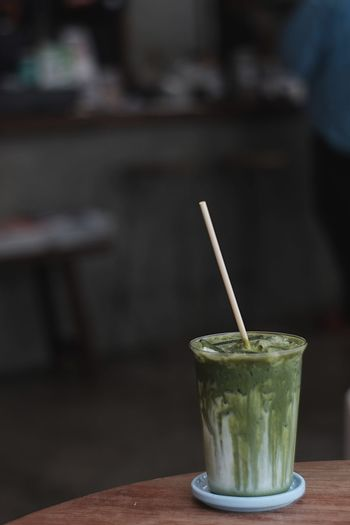 MatchaLatte Matcha Straw Drinking Straw Table Drink Refreshment Food And Drink Glass Drinking Glass Indoors  Focus On Foreground Household Equipment Freshness Food Healthy Eating Close-up Wellbeing Still Life Wood - Material No People Herb
