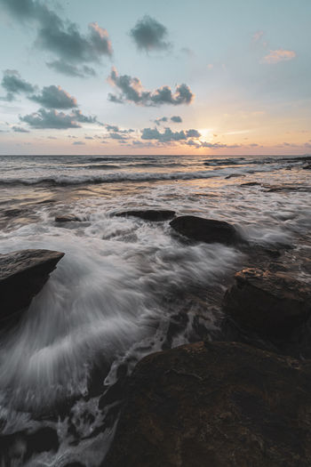Water Sky Sea Beauty In Nature Scenics - Nature Sunset Rock Cloud - Sky Motion Land Beach Horizon Over Water Solid Rock - Object Horizon Nature No People Idyllic Sport Outdoors Flowing Water Power In Nature