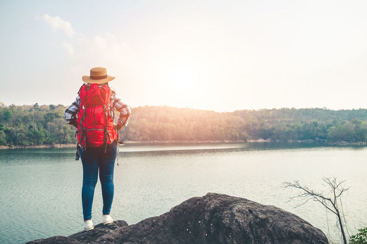 Hat Nature One Person Leisure Activity Water Beauty In Nature Outdoors Standing Sky Landscape Women Travel Backpack Backpacker Sunlight Scenics - Nature Rock - Object Lifestyles Tranquility