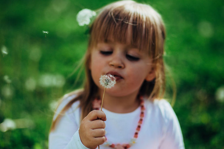 Close-up of cute girl eating ice cream