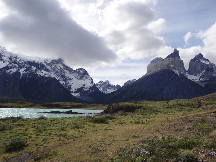 Beauty In Nature Cloud - Sky Cold Temperature Day Environment Grass Landscape Mountain Mountain Peak Mountain Range Nature No People Outdoors Patagonia Range Scenery Scenics - Nature Sky Snow Snowcapped Mountain Torres Del Paine Water Wilderness