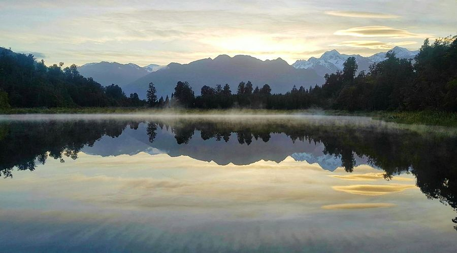 Reflection on Lake Matheson Reflections In The Water Reflection_collection Reflection Photography Lake View Water Reflections Landscape Water Tranquility Mountains Trees Sunrise Determination