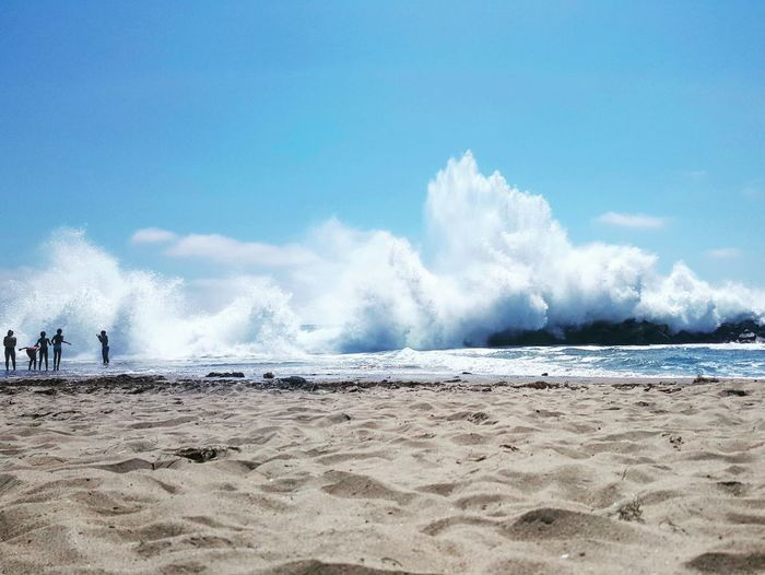 Beach Sea Sand Wave Water Motion Splashing Sky Power In Nature Horizon Over Water Beauty In Nature Outdoors Summer Day Blue Clear Sky Spraying People Visual Inspiration EyeEm Selects Huge Waves