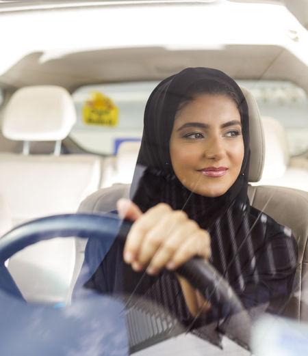 Woman wearing burka while driving car