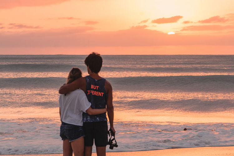 Same same, but very different. A couple sharing a breathtaking sunset at Jolly Beach in Antigua | @LostBoyMemoirs SEE MORE: Instagram: @LostBoyMemoirs Lostboymemoirs.com 2018 In One Photograph Moments Of Happiness It's About The Journey Caribbean Sea Island Island Life Paradise Vacations Colorful Sailing Antigua Antigua And Barbuda Holiday Travel Travel Destinations Tourism Young Happiness Couple - Relationship Positive Emotion Leisure Activity Horizon Over Water Togetherness Beauty In Nature Bonding Sunset