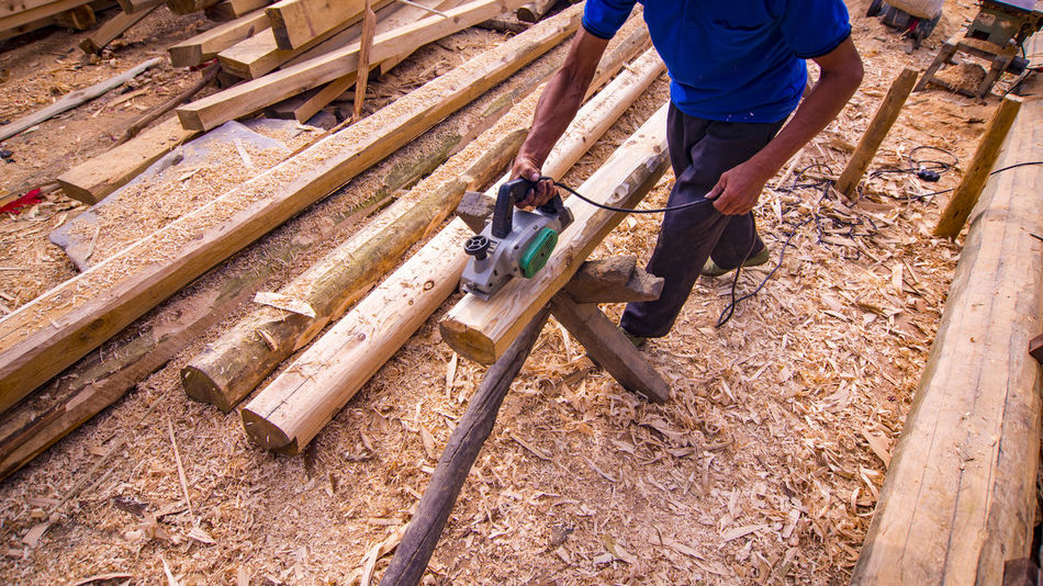 Adult Adults Only Construction Site Construction Worker Cutting Day Human Body Part Human Hand Industry Low Section Maintenance Engineer Manual Worker Men Occupation One Man Only One Person Only Men Outdoors People Real People Wood - Material Working