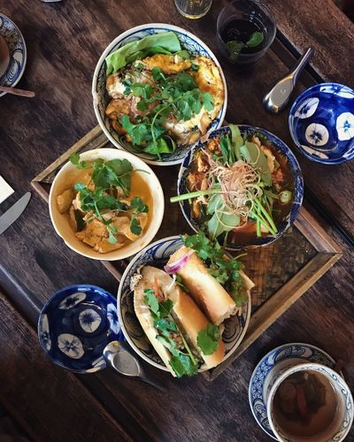 Vietnamese lunch Family Lunch Nutrition Curry Tofu Tasty Set Table Chinese Vietnamese Food Lunch Asian  Food And Drink Table Ready-to-eat Food Freshness Bowl High Angle View No People Salad Wood - Material Healthy Eating Plate Indoors  Lettuce Meal Day Meat Close-up