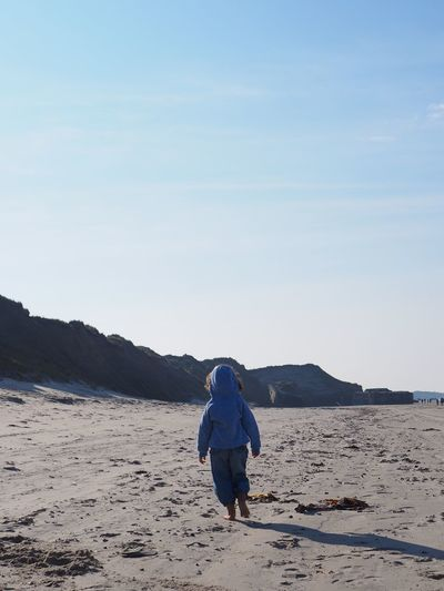 Walking on Løkken beach in North Jutland, Denmark Rear View Sky Beauty In Nature Beach Sand Blue Child Childhood Way Path Explore Walking barefoot Walking Away Determined Leading Going Ahead Go Ahead Alone Outdoors Scenics - Nature Sea Jutland Dunes Width