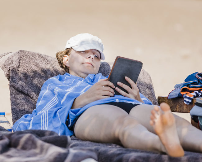 Woman reading on beach - Cirali, Antalya Province, Turkey Adult Beach Bed Caucasian Chair Comfortable Computer Convenience Deck Digital Down E-reader Female Full Length Hand Happy Hobby Holding Internet Ipad Kindle Learning Leisure Looking Down Lounge Lying Mid Nature One Outdoors People Portability Portrait Reading Relaxation Sand Serious Summer Sun Surfing Tablet Tanning Technology Towel Using Vacations Wellbeing Woman Wrapped Wireless Technology Communication One Person Connection Real People Digital Tablet Lifestyles Lying Down Leisure Activity Selective Focus
