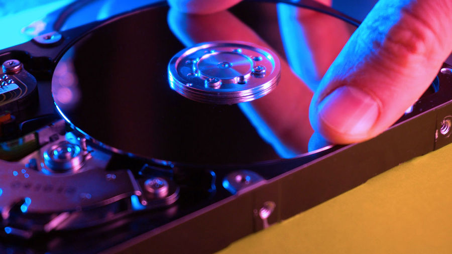 Repairing of HDD Technology Blue Close-up Human Hand Indoors  Human Body Part Hand Machinery Equipment Control Healthcare And Medicine People Communication High Angle View Turntable Record Science Focus On Foreground Nightlife Mixing