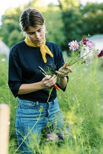 Man holding flower bouquet on field