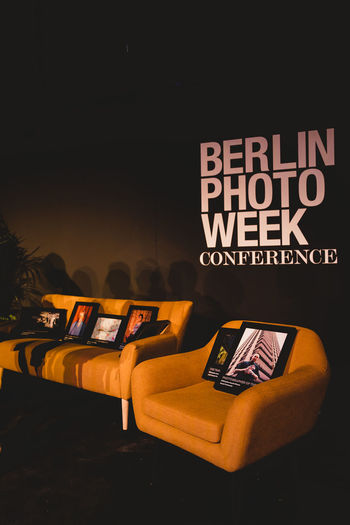 Berlin Photo Week 2018 Berlin Photo Week BPW18 EyeEem Communication Text Western Script No People Indoors  Illuminated Night Capital Letter Close-up Seat Technology Still Life Sign Finance Business Dark Orange Color Black Color Currency Connection Message