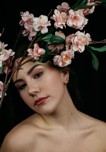Editorial  Flower Flowering Plant Portrait One Person Headshot Beauty Studio Shot Plant Beautiful Woman Young Adult Beauty In Nature Black Background Close-up Adult Nature Women Freshness Indoors  Contemplation