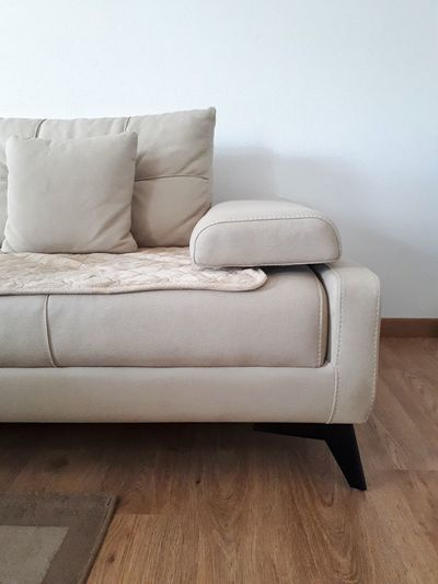 Close-up of sofa against white wall at home