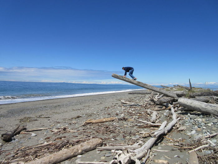 Sky's the Limit Strait Of Juan De Fuca Beach Climbing Driftwood Dungeness Spit Land Motion One Person Outdoors Sea Sky Spit Teenage Boys Teenager