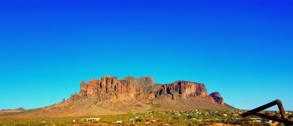 Scenic view of superstition mountains against clear sky