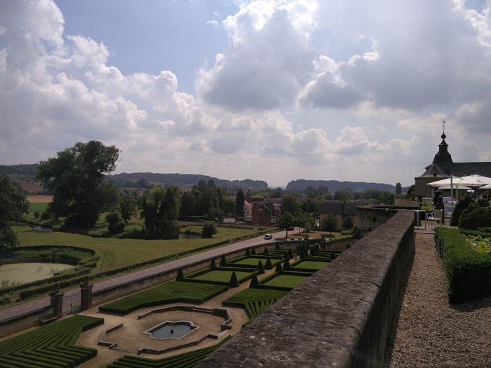 High angle view of chateau neercanne garden against cloudy sky