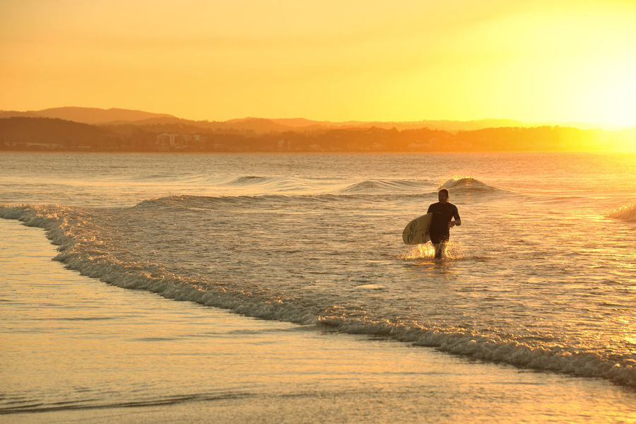 A surfer at Snapper Rocks, Coolangatta, Qld. Gold Coast Australia Sunlight Sunset_collection Surf Adventure Australia & Travel Beach Beauty In Nature Mountain Nature One Person Outdoors Scenics Sea Silhouette Sky Sunset Sunshine Surfing Surfingphotography Travel Destinations Water Wave