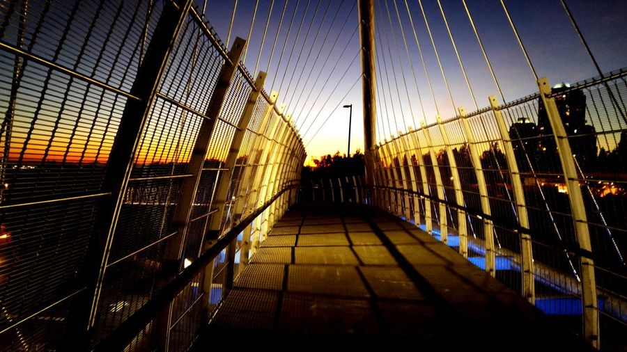 Suspension Bridge Bridge - Man Made Structure Sky Connection Architecture Built Structure Sunset Outdoors Water City Day People