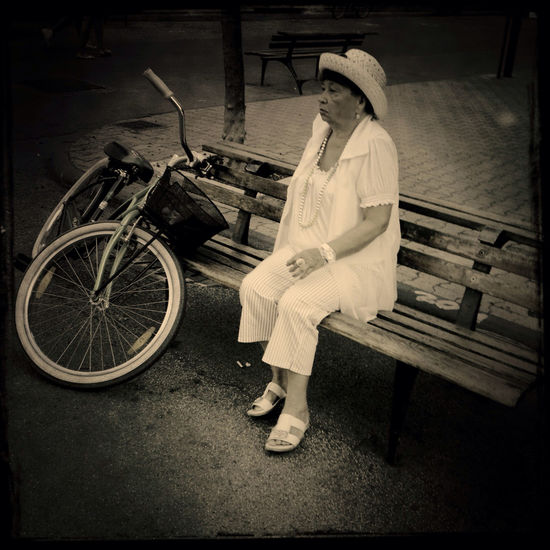 Old lady with bicycle