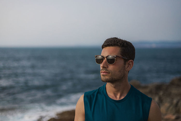 Summertime Fashion Front View Glasses Headshot Horizon Horizon Over Water Land Lifestyles One Person Outdoors Portrait Real People Sea Sky Summer Sunglasses Water Young Adult Young Men