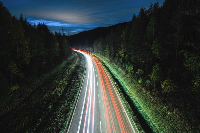 Weekend! Time for a short trip🚗🏍 —————————————————— I wanted to take this picture for a long time, but unfortunately i never had time... but now 💪🏼 Pflach Landscape Composition Langzeitbelichtung Long Exposure Transportation Light Trail Road Long Exposure Illuminated Plant Highway The Way Forward Tree Night Direction Motion Nature No People Speed Sky Tail Light Traffic Headlight Mode Of Transportation