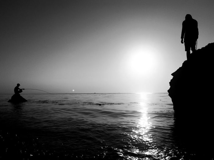 Good Friday Fishing Blackandwhite Bnw_friday_eyeemchallenge Bnw Water Sea Sky Silhouette Beauty In Nature Real People Inner Power Leisure Activity Rock Lifestyles Scenics - Nature Men Nature Tranquil Scene