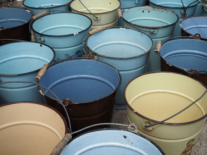 High angle view of metal buckets for sale in flea market