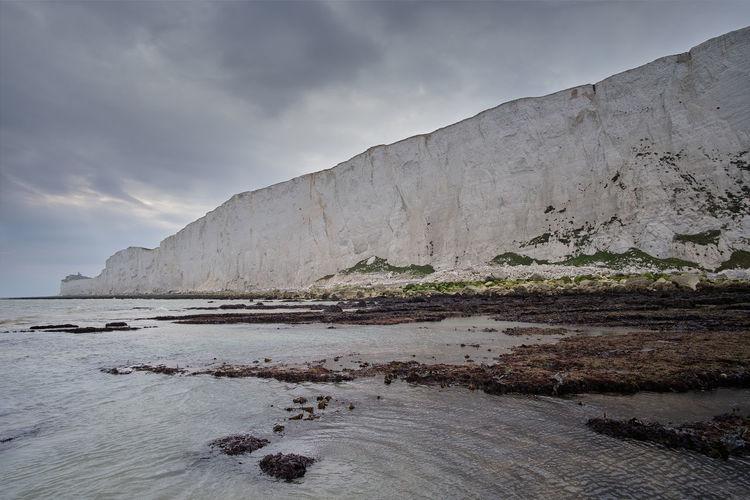 Seven sisters chalk cliffs at low tide near eastbourne, east sussex, united kingdom
