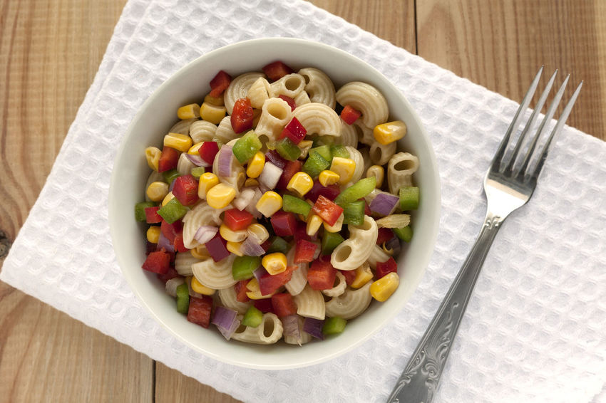 Summer Macaroni Salad bowl on white napkin with fork. Fork Natural Light Salad Close-up Corn Grain Food Food And Drink Freshness Green Peppers Healthy Eating Macaroni Pasta Macaroni Salad  No People Ready-to-eat Red Peppers Studio Photography Summer Salad Temptation Vegetable White Napkin