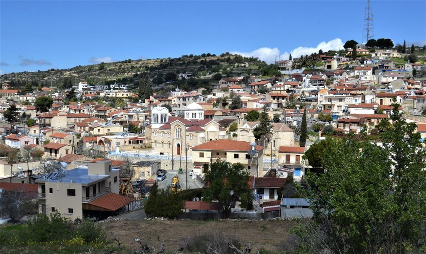 Looking across the valley to the Cypriot stone built village houses and rooftops of Pachna village, Limassol district of Cyprus. Cyprus Village Mediterranean Landscape Rooftop Architecture Building Building Exterior Built Structure City Cityscape Community Crowd Crowded Day High Angle View House Mountain Nature Outdoors Plant Residential District Sky Town TOWNSCAPE Tree The Art Of Street Photography