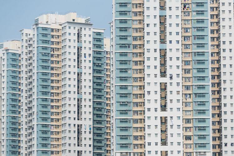 Full frame shot of residential buildings against sky