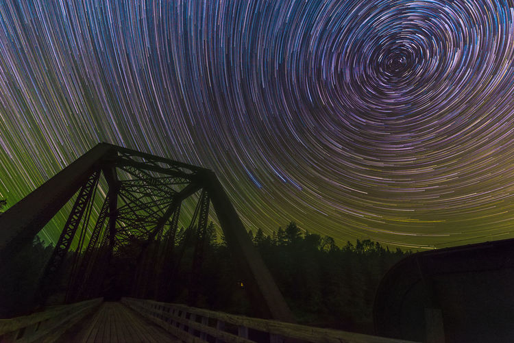 A night out under the stars! Arundel, Quebec! Bridge And Star Nikon D750 Old Bridge Polaris Tamron 15-30mm Astronomy Beauty In Nature Bridge Canada Concentric Galaxy Landscape Long Exposure Motion Nature Night No People North Star Outdoors Quebec, Canada Scenics Sky Space Star Trail Tree