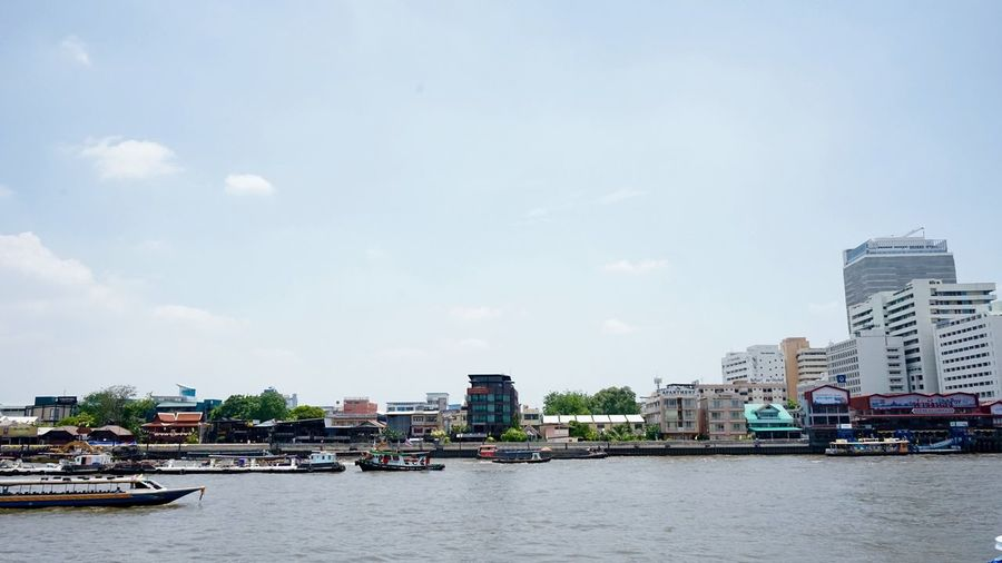 Chao Phaya river Built Structure Building Exterior Architecture Water City Sky Waterfront Transportation Building Nature Mode Of Transportation Nautical Vessel Cloud - Sky Residential District Day Outdoors Incidental People River Office Building Exterior Cityscape