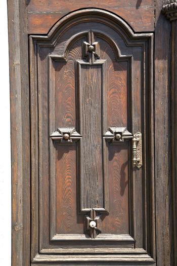 Full frame of wooden door with handle