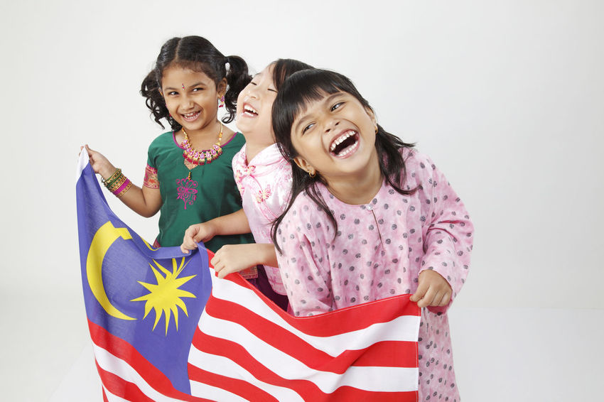 Celebration Happiness Indian National Day Patriotism Traditional Clothing Child Childhood Chinese Flag Front View Girls Happiness Harmony Innocence Malay Ethnicity Malaysia Malaysian Merdeka Multi Racial Positive Emotion Smiling Togetherness White Background Women