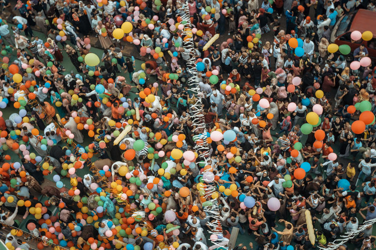 High angle view of group of people in street