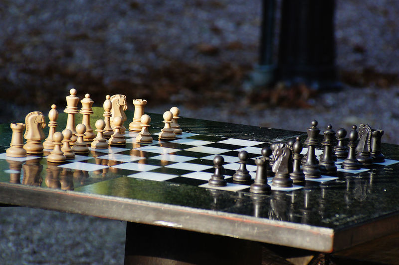 Close-up of arranged chess board on table